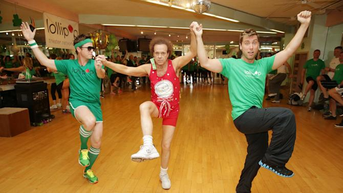 Billy Bush, Richard Simmons and Lance Bass at St. Patty's Day Slimdown benefiting the Lollipop Theatre Network held at Slimmons on Sunday, Mar., 17, 2013 in Beverly Hills, CA. (Photo by Eric Charbonneau/Invision for Lollipop Theatre Network/AP Images)