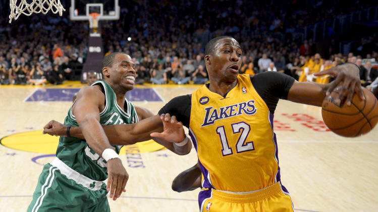 Los Angeles Lakers center Dwight Howard (12) battles Boston Celtics center Jason Collins for a rebound during the first half of their NBA basketball game, Wednesday, Feb. 20, 2013, in Los Angeles. (AP Photo/Mark J. Terrill)