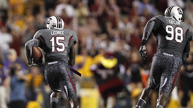 South Carolina cornerback Jimmy Legree (15) returns an interception 70 yards during the first half of an NCAA college football game against LSU in Baton Rouge, La., Saturday, Oct. 13, 2012. (AP Photo/Gerald Herbert)