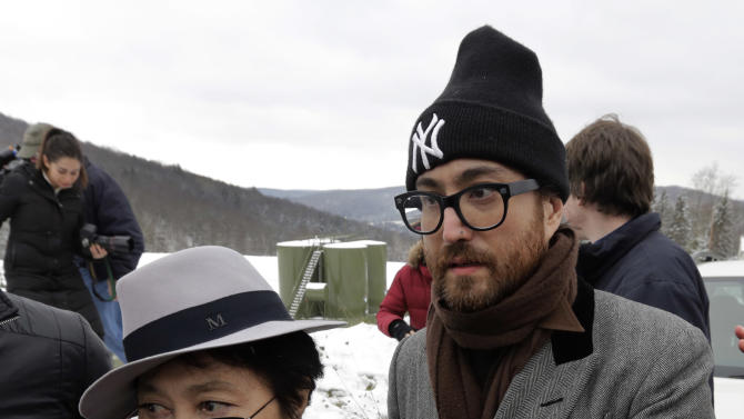 Yoko Ono, left, and her son Sean Lennon visit a fracking site in Franklin Forks, Pa, Thursday, Jan. 17, 2013. They are on a bus tour of natural-gas drilling sites in northeastern Pennsylvania and plan to visit with residents who say they've been harmed by the controversial extraction process known as fracking.(AP Photo/Richard Drew)