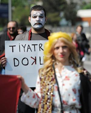 "Artists carry a banner that reads "" don't touch my theaters!"" during a May Day rally in Istanbul, Turkey, Tuesday, May 1, 2012. Turkey, a candidate for membership in the European Union, is less strict than many other nations in the region. But Prime Minister Recep Tayyip Erdogan on Sunday backed a move by Istanbul's mayor to take over decision-making in the Istanbul City Theaters group, which is funded by the city and staged the play that outraged conservative critics.(AP Photo)"