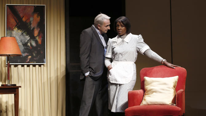 "FILE - In this Nov.15, 2012 file photo, French actor Eric Debrosse acting as former International Monetary Fund leader Dominique Strauss-Kahn, centre left, and actress Jelle Saminnadin acting as Nafissatou Diallo, the hotel housekeeper, who accused Dominique Strauss-Kahn of sexually assaulting her, pose during a photo opportunity as they perform in a play ""Suite 2806"" in a Paris theatre. One-time French presidential hopeful Dominique Strauss Kahn has been to hell and back since he was charged, then acquitted in New York of  making a hotel maid perform a sexual act in 2011. Now DSK will be treading the boards, in a salacious new play that recounts knock for knock what might have happened in the now infamous suite of the Manhattan Sofitel hotel. (AP Photo/Christophe Ena, File)"