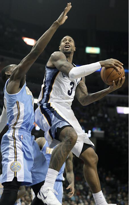 Memphis Grizzlies' James Johnson (3) goes to the basket in front of Denver Nuggets' Quincy Miller, left, during the second half of an NBA basketball game in Memphis, Tenn., Saturday, Dec. 28,