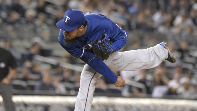 Texas Rangers pitcher Yovani Gallardo delivers the ball to the New York Yankees during the second inning of a baseball game Sunday, May 24, 2015, at Yankee Stadium in New York. (AP Photo/Bill Kostroun)