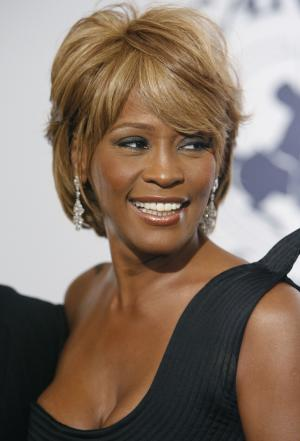FILE- In this Oct. 28, 2006, file photo, singer Whitney Houston arrives at the 17th Carousel of Hope Ball benefiting the Barbara Davis Center for Childhood Diabetes in Beverly Hills, Calif. Houston died Saturday, Feb. 11, 2012, she was 48. (AP Photo/Matt Sayles)