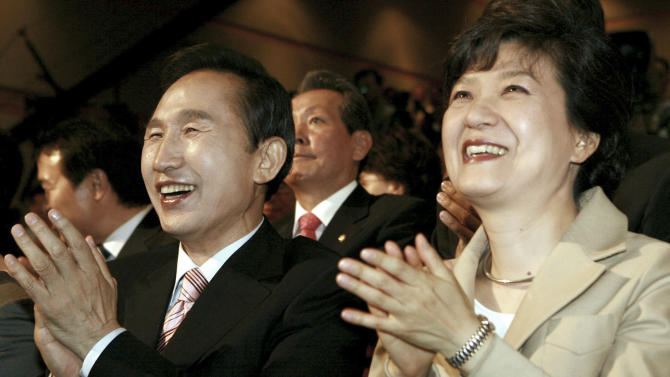 "FILE - In this Tuesday, May 29, 2007 file photo, South Korea's opposition Grand National Party presidential contenders Lee Myung-bak, left, and Park Geun-hye clap as they participate in a public hearing in Kwangju, south of Seoul, South Korea. Park served five terms in the legislature and earned the nickname ""Queen of Elections"" for her ability to win tight races. She only narrowly lost in presidential primaries five years ago to current conservative President Lee, whose single term ends in February. Park attempts to become the country's first female president and keep the government in conservative hands in the Dec. 19, 2012 election. (AP Photo/Yonhap, Baek Sung-ryul, File) KOREA OUT"