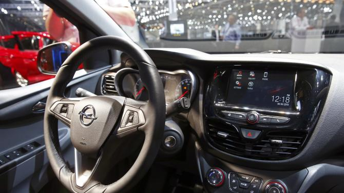 The steering wheel and dashboard are seen inside an Opel Karl during the second press day ahead of the 85th International Motor Show in Geneva