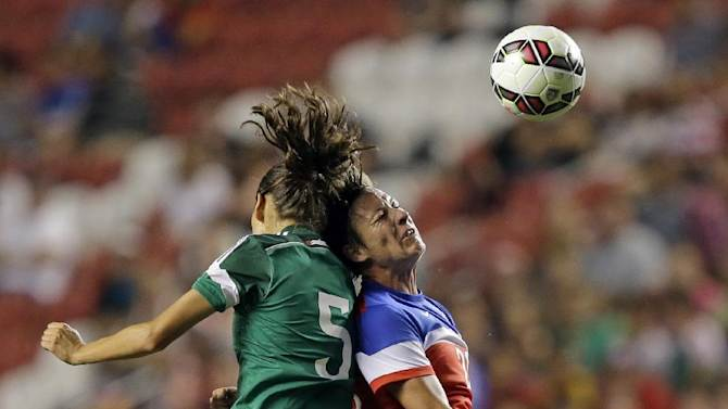 FILE - In this Sept. 13, 2014, file photo, United States' forward Abby Wambach, right, heads the ball as Mexico defender Paulina Solis (5) defends during the first half of an international friendly game, in Sandy, Utah. A group of elite players has filed a lawsuit in Canada challenging plans to play the 2015 Women's World Cup on artificial turf. The players, led by U.S. women's national team forward Abby Wambach, filed Wednesday, Oct. 1, 2014, in the human rights tribunal of Ontario next week, attorney Hampton Dellinger said.  (AP Photo/Rick Bowmer, File)
