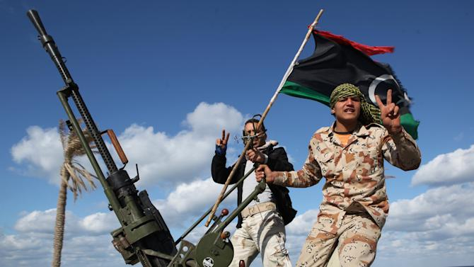 FILE - In this Tuesday Feb. 14, 2012 file photo, Libyan militias from towns throughout the country's west parade through Tripoli, Libya. Libya's upheaval the past two years helped lead to the ongoing conflict in Mali, and now Mali's war threatens to wash back and further hike Libya's instability. There is a growing fear that post-Moammar Gadhafi Libya is becoming an incubator of turmoil, with an overflow of weapons and Islamic jihadi militants operating freely, ready for battlefields at home or abroad. (AP Photo/ Abdel Magid Al Fergany, File)