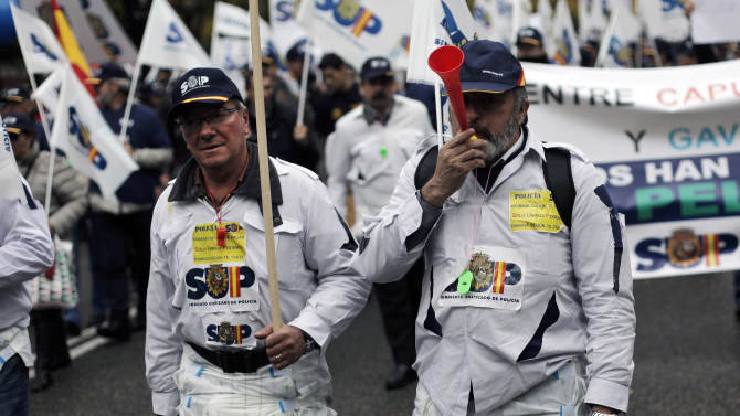 Police march wearing diapers as they protest  against government's austerity measures and the elimination of their Christmas bonus pay, one of 14 paychecks that most Spanish civil servants get each year, in Madrid, Spain, Saturday, Nov. 17, 2012. Significance of the diapers  is unclear. (AP Photo/Andres Kudacki)