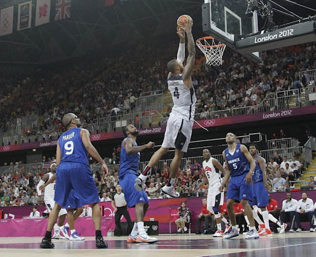USA's Tyson Chandler (4) goes in for a dunk during the second half of a preliminary men's basketball game against France at the 2012 Summer Olympics, Sunday, July 29, 2012, in London. The U.S. men bea