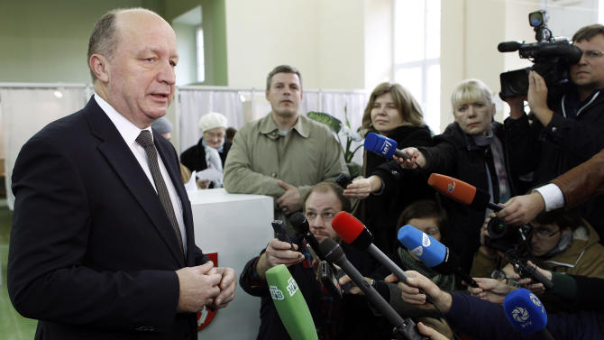 Lithuania's Prime Minister and Homeland Union leader Andrius Kubilius speaks to the media at a polling station in Vilnius, Lithuania, Sunday, Oct. 14, 2012. Lithuanians are expected to deal a double-blow to the incumbent conservative government in national elections Sunday by handing a victory to opposition leftists and populists and saying 'no' to a new nuclear power plant that supporters claim would boost the country's energy independence. (AP Photo/Mindaugas Kulbis)