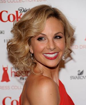 "FILE - In this Feb. 11, 2010 file photo, television personality Elisabeth arrives at The Heart Truth's Red Dress Collection 2010 fashion show in New York. Hasselbeck is staying put as a co-host of ""The View"" despite reports insisting otherwise. Series co-creator Barbara Walters called that story ""particularly false"" on the Monday, March 11, 2013 edition of the ABC daytime talk show. (AP Photo/Evan Agostini, File)"