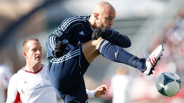 "New England Revolution keep it simple, hold serve in Sporting Kansas City ""dogfight"""