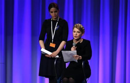 Ukrainian opposition politician Tymoshenko speaks as her daughter Yevgenia looks on at the EPP Elections Congress in Dublin