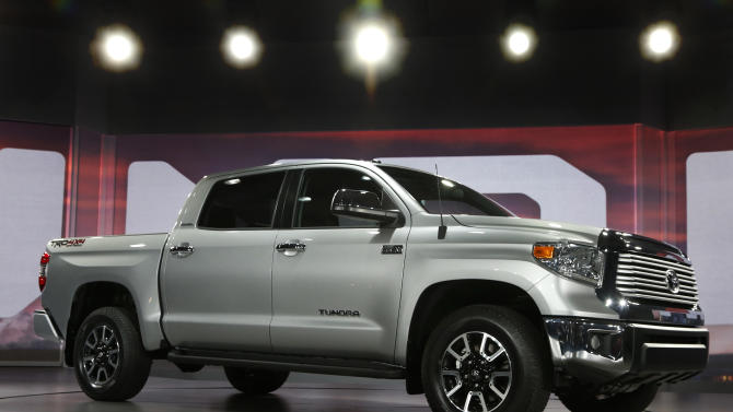 FILE - In this Thursday, Feb. 7, 2013, file photo, the redesigned 2014 Toyota Tundra is unveiled at the Chicago Auto Show, 2013, in Chicago. In its first major update since 2007, the full-size Toyota Tundra pickup truck is redesigned with a bold, American-style exterior, a refined, quieter interior and standard backup camera and Bluetooth phone and audio connectivity. (AP Photo/Charles Rex Arbogast, File)