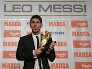 Barcelona&#39;s Argentinian forward Lionel Messi poses after receiving the European Golden Boot 2012 award for best European goalscorer of the 2011-2012 season, in Barcelona. Fresh from hitting his 300th career goal in a weekend swamping of Rayo Vallecano, Messi heads a 23-strong shortlist for a fourth FIFA/France Football Ballon d&#39;Or (Golden Ball) award