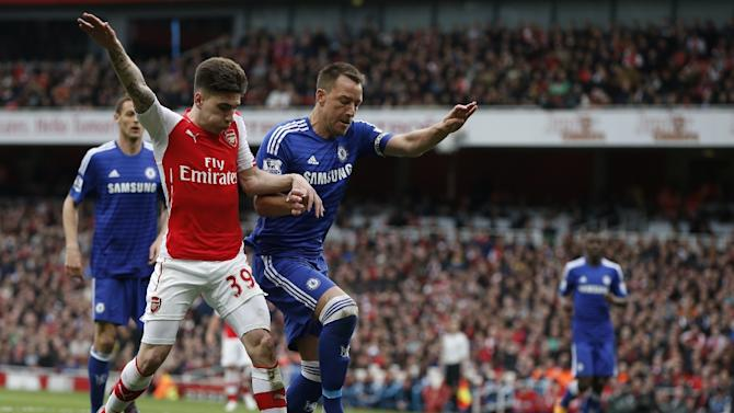 Arsenal's defender Hector Bellerin (L) vies with Chelsea's defender John Terry during the English Premier League football match at the Emirates Stadium in London on April 26, 2015
