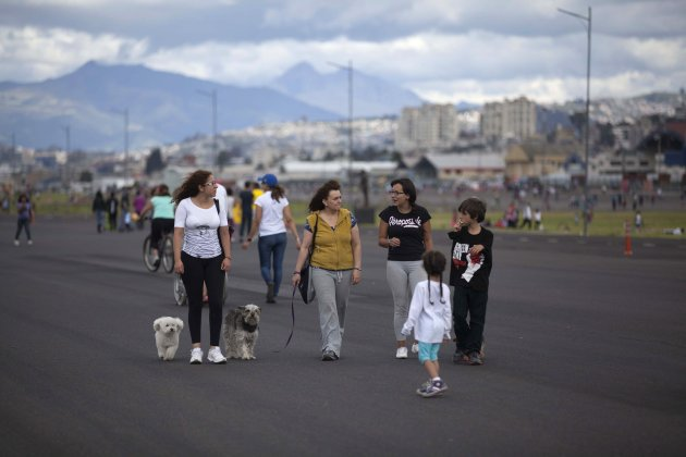 People walk their dogs on the tracks of Quito's Old Mariscal Sucre International Airport, in Tababela
