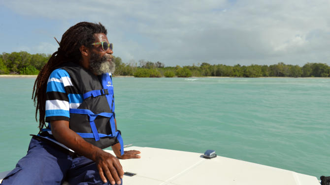In this June 13, 2013 photo, warden Owen Turner patrols the Bluefields Bay marine reserve in southwestern Jamaica. This long stretch of water, patrolled daily by a small team of wardens and marine police, is one of a growing number of no-fishing zones in the Caribbean, where most coastal reefs have been severely damaged by overfishing, pollution, and more recently global warming. (AP Photo/David McFadden)