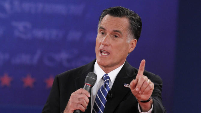 U.S. Republican presidential nominee Romney answers a question as he debates President Obama during the second U.S. presidential campaign debate in Hempstead