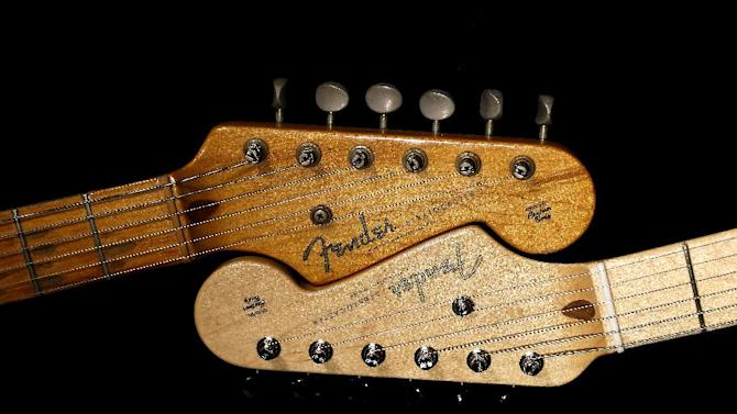 An original 1954 Fender Stratocaster head stock, left, is shown next to a 2014 model, Friday, Jan. 10, 2014 at a studio in Scottsdale, Ariz. April 2014 marks the 60th anniversary of the very first Stratocaster ever sold. (AP Photo/Matt York)