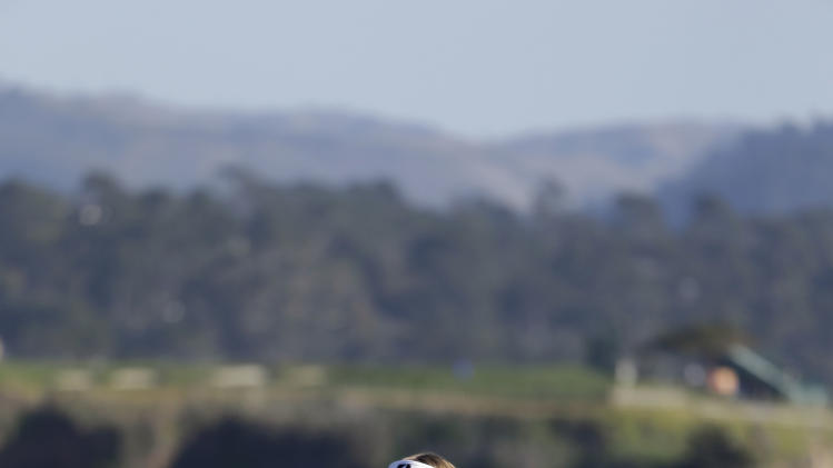 Brandt Snedeker pumps his fist on the 18th green of the Pebble Beach Golf Course after winning the AT&T Pebble Beach Pro-Am golf tournament on Sunday, Feb. 10, 2013, in Pebble Beach, Calif. (AP Photo/Eric Risberg)