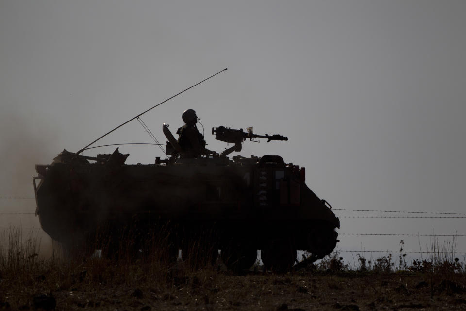 Israeli soldiers from the Golani brigade drive their APC (Armored Personnel Carrier) during a military exercise in the Israeli-controlled Golan Heights near the border with Syria, Tuesday, June 25, 2013. (AP Photo/Ariel Schalit)