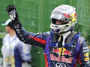 Sebastian Vettel of Germany celebrates after taking pole position at the qualifying session of the Brazilian F1 Grand Prix at the Interlagos circuit in Sao Paulo