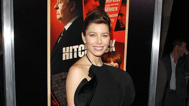 "Back in La La Land, newlywed Jessica Biel popped by the premiere of ""Hitchcock"" in this polarizing frock. What do you make of Mrs. Timberlake's ruffled Gucci gown, sleek updo, and mustard-yellow Fendi clutch? Hot or not? (11/20/2012)"