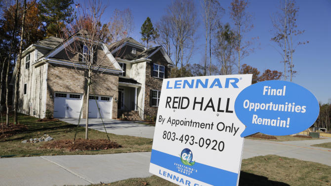 In this Thursday, Nov. 14, 2013, photo, a home is advertised for sale in Matthews, N.C. The National Association of Realtors reports on sales of previously occupied homes in October on Wednesday, Nov. 20, 2013. (AP Photo/Chuck Burton)