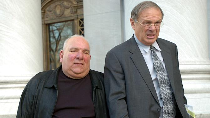 File -- In this Tuesday, Feb. 15, 2005 file photo Alfred Scivola, Jr., of Rhode Island, left, and his attorney, John Cicilline, leave U.S. District Court in New Haven, Conn., after Scivola pleaded guilty to attempted extortion. Scivola, a New England Mafia member, was ordered on Thursday, June 7, 2012 to serve three years and 10 months in federal prison for his role in the shakedown of Rhode Island strip clubs, becoming the second admitted mobster and fifth person overall to be sentenced in the case. (AP Photo/Bob Child, File)