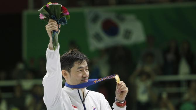 Jung holds his gold medal on the podium at a medal ceremony for epee bout in the men's individual competition at Goyang Gymnasium, during the 17th Asian Games in Incheon