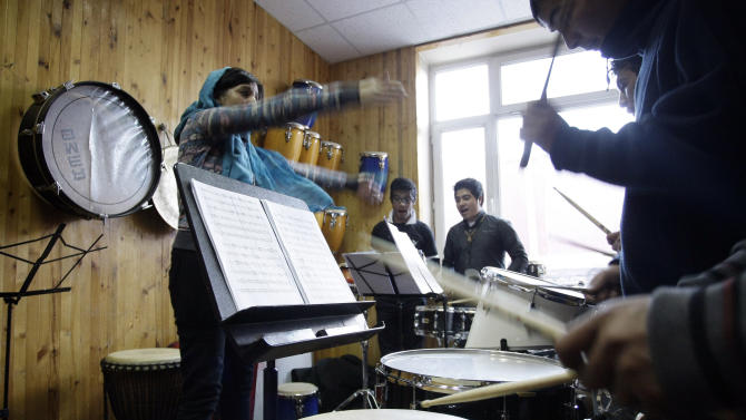 In this Monday,  Jan. 7, 2013 photo, Norma Ferreira, left, from Mexico, teaches Afghan students how to play drum in a class at the Afghanistan National Institute of Music in Kabul, Afghanistan. Dozens of Afghan teenagers including former street kids or orphans aged 10 to 22, will be playing in the Afghan Youth Orchestra which begins a 12-day U.S. tour on Feb. 3 and includes concerts at Washington's Kennedy Center - President Barrack Obama has been invited - New York's Carnegie Hall and the New England Conservatory in Boston. (AP Photo/Musadeq Sadeq)