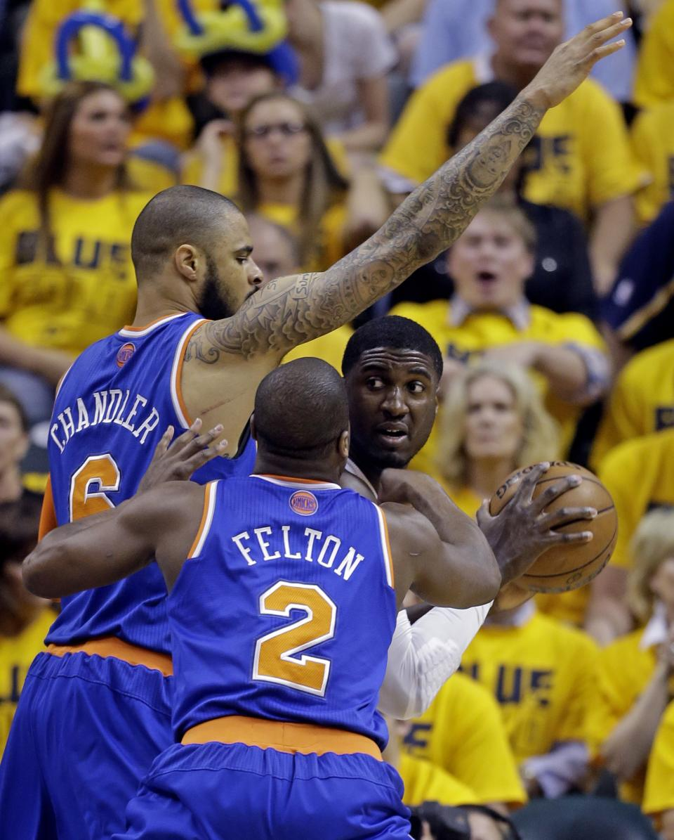Indiana Pacers' Roy Hibbert is double teamed by New York Knicks' Raymond Felton (2) and Tyson Chandler during the first half of Game 6 of an Eastern Conference semifinal NBA basketball playoff series Saturday, May 18, 2013, in Indianapolis. (AP Photo/Darron Cummings)