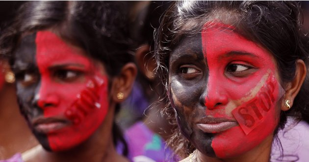 Sri Lankan women looks on before a protest to mark International Women's Day in Colombo