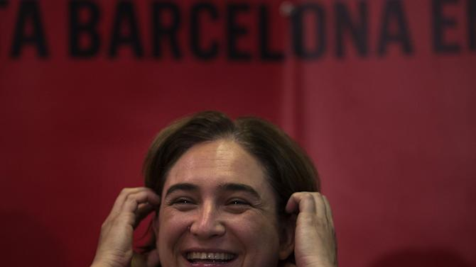 Leading Spanish social activist Ada Colau, who beat the candidate of the Catalonia region's long-dominant conservative Convergence and Union party in Sunday's local elections, smiles during a press conference in Barcelona, Spain, Monday, May 25, 2015. Colau says the fight against evictions, poverty and corruption will be her priority as new mayor of the country's second city, Barcelona. (AP Photo/Emilio Morenatti)