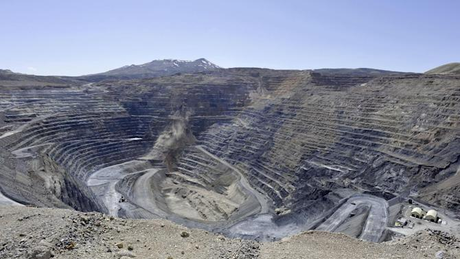 "FILE - This April 4, 2012 file photo shows the Newmont Gold Quarry pit in Battle Mountain, Nev. While the U.S. government reaps billions of dollars in royalties each year from fossil fuels extracted from federal public lands and waters, it does not collect any royalties from gold, uranium or other metals mined from the same lands, Congressional auditors reported Wednesday Dec. 12, 2012. A Government Accountability Office report found that the federal government doesn't even know how much these so-called ""hard rock"" mines produce from federal public lands in 12 Western states _ where most of the mining occurs. (AP Photo/The Reno Gazette-Journal, David B. Parker, file)  NEVADA APPEAL OUT; NO SALES"