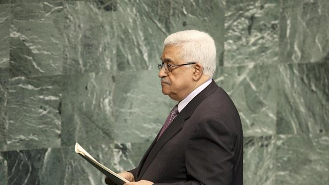 "FILE - Palestinian President Mahmoud Abbas leaves the podium after speaking during the 67th session of the United Nations General Assembly at U.N. headquarters in this Thursday, Sept. 27, 2012 file photo. Palestinian leaders plan to shake up the 19-year-old peace process and proceed with a United Nations statehood bid in November over U.S. objections. The move to upgrade the their status to that of a ""non-member state"" in the UN General Assembly comes a year after the failed effort to obtain full membership through the Security Council, a step the Obama administration blocked. (AP Photo/Seth Wenig)"