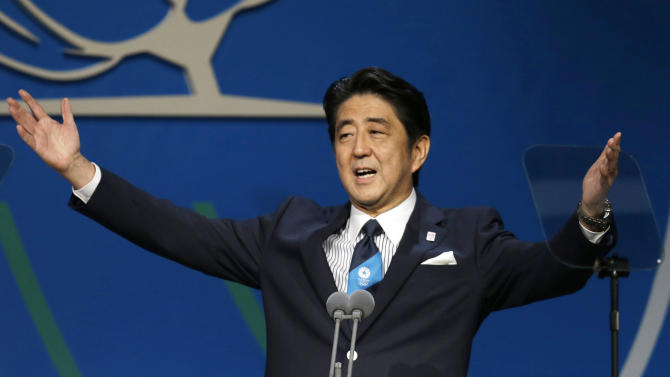 """FILE - In this Sept.7, 2013 file photo, Japan's Prime Minister Shinzo Abe, addresses the International Olympic Committee session during the Tokyo 2020 bid presentation in Buenos Aires, Argentina. Abe's reassurance to the International Olympic Committee that contaminated water leaks from the crippled Fukushima nuclear plant are """"under control"""" has backfired at home. (AP Photo/Natacha Pisarenko, File)"""