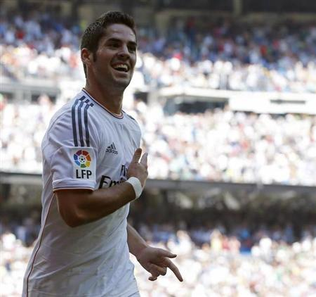 Real Madrid's Isco celebrates his goal during their Spanish first division soccer match against Athletic Bilbao at Santiago Bernabeu stadium in Madrid