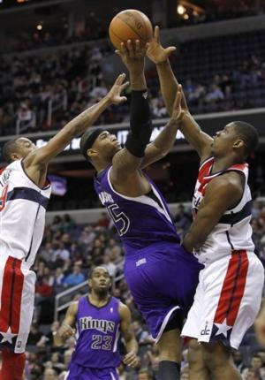 Kings break 6-game skid, beat Wizards 115-107