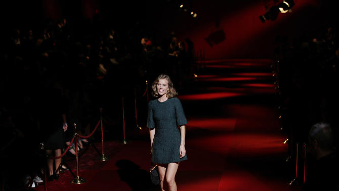 Top model Eva Herzigova poses on the runway prior to a Dolce&Gabbana women's spring-summer 2015 show, part of the Milan Fashion Week, unveiled in Milan, Italy, Sunday, Sept. 21, 2014. (AP Photo/Luca Bruno)