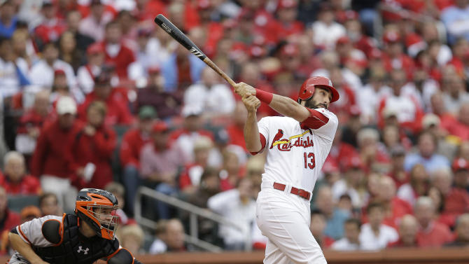 St. Louis Cardinals' Matt Carpenter (13) watches the ball as he hits a two-run home run during the third inning of Game 3 of baseball's National League championship series against the San Francisco Giants, Wednesday, Oct. 17, 2012, in St. Louis. (AP Photo/David J. Phillip)