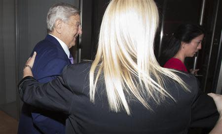 Billionaire George Soros and his fiancee Tamiko Bolton arrive at the Museum of Modern Art in New York