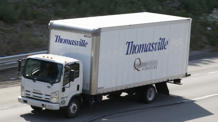 In this Friday, June 21, 2013 photo, a Thomasville Furniture truck moves through traffic on Interstate 79 near Evans City, Pa. The Commerce Department reports, Tuesday, July 2, 2013, on orders placed with U.S. factories in May. (AP Photo/Keith Srakocic)