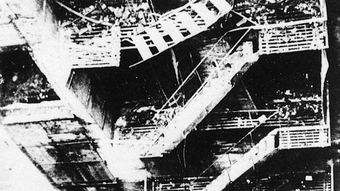 FILE - This is a 1911 file photo of the collapsed remains of the fire escape of the Triangle Shirt Waist Company in New York City. One hundred years ago, horrified onlookers watched as workers leapt to their deaths from the raging fire in the garment factory. The fire killed 146 workers, mainly young immigrant women and girls, and became a touchstone for the organized labor movement, spurred fire-safety laws and shed light on the lives of immigrant workers. (AP Photo/File)