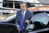 Greek Conservative New Democracy party's leader Antonis Samaras arrives at his headquarters for a televised statement, after his meeting with political leaders of other parties. A first round of government talks in Greece ended in stalemate on Monday after the top-seeded conservative party failed to entice parties opposed to the country's EU-IMF bailout deal to join a coalition
