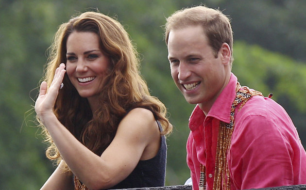 Britain's Prince William and his wife Kate, the Duke and Duchess of Cambridge, smile as they watch a shark ceremony as they arrive at Marapa Island, Solomon Islands, Monday, Sept. 17, 2012. (AP Photo/Rick Rycroft, Pool)