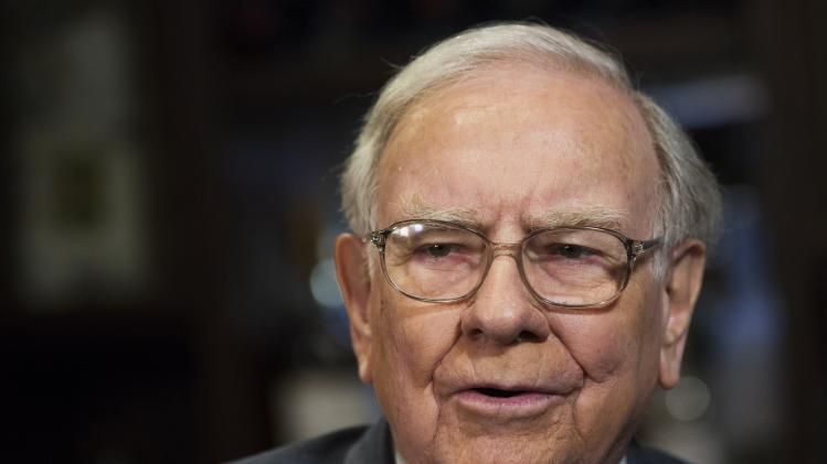 Investor Warren Buffett poses for a portrait during an interview after a luncheon to benefit the Glide Foundation of San Francisco in New York